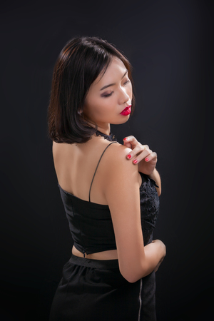 sexy asian woman: Portrait of beautiful Thai young girl on black background Stock Photo