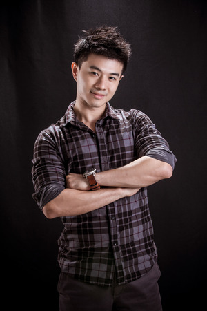 smily: Portrait of Asian young man on black background -smily handsome young man