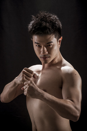 topless: Topless portrait of Asian young man - Fighter concept, Muaythai, boxing Stock Photo