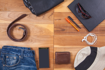 Outfits and accessories of traveler on wooden background with copy space, Travel concept Stock Photo
