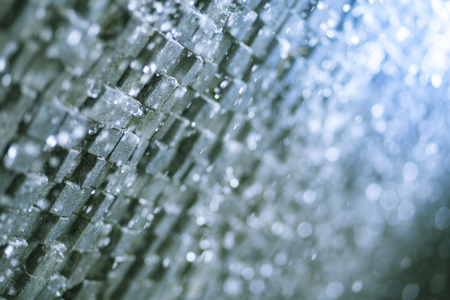 Abstract background of water fall on cube wall with bokeh and copy space