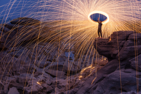 Amazing fire spin use long exposure, self portrait at Sam pan bok, North-east of Thailand