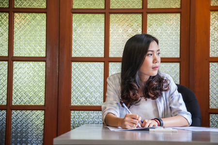 Beautiful Asian young girl work in coworking space