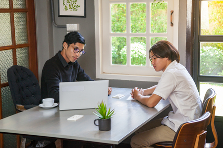 Tutor teacher and student in coworking space  do workshop