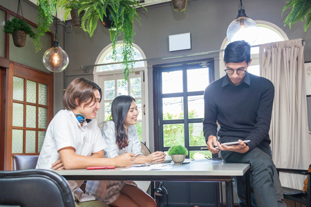 Young teacher and student in coworking space