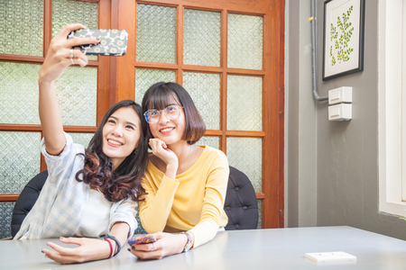 Friendship concept of asian girls in office