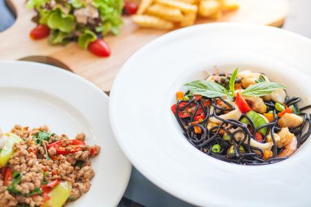 Sea food Black spaggettu, basil pork and potato fried, Spicy meal
