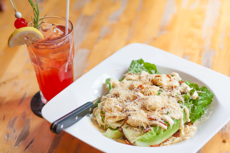 caesar salad with cheese seasoning, refresh drink