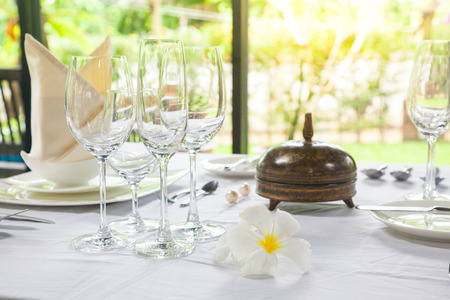 Silver service dining room decoration, wine glass, plate, white theme Stock Photo