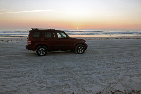 Driving on the beach at sunrise