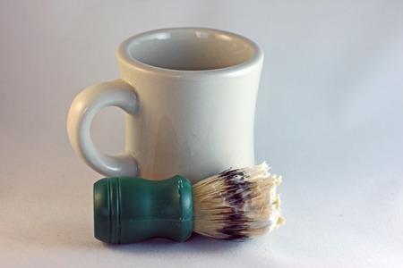 old shaving brush, soap and mug