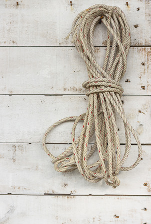 nylon: A roll of  nylon rope hanging on the wall.