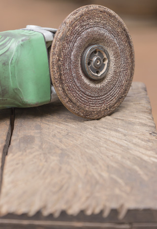 furrow: The grinder makes furrow to wooden chair.