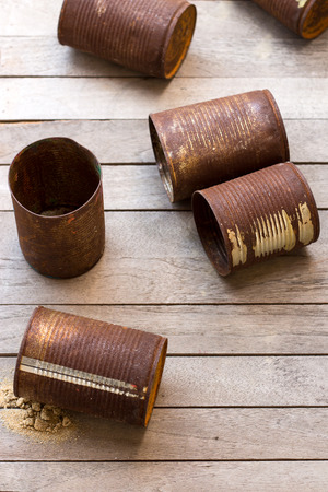 discard: rusty cans on slat. Stock Photo