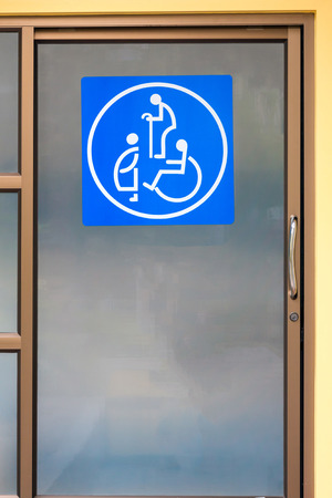 expectant mother: Sign of oldster, expectant mother and cripple on toilet door