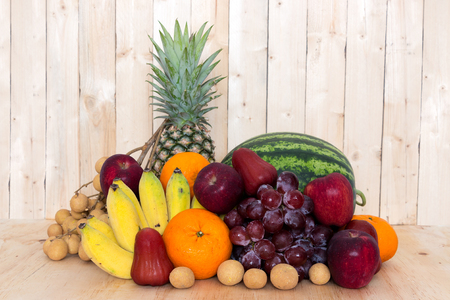 assortment: Assortment of exotic fruits on wooden background