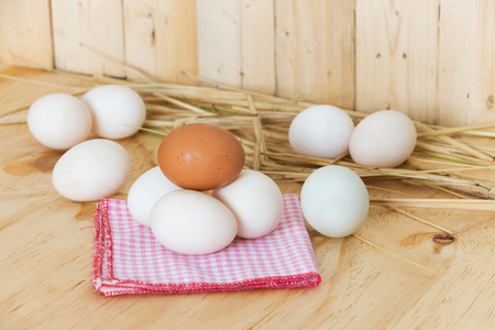 hanky: Eggs on red hanky on wooden background