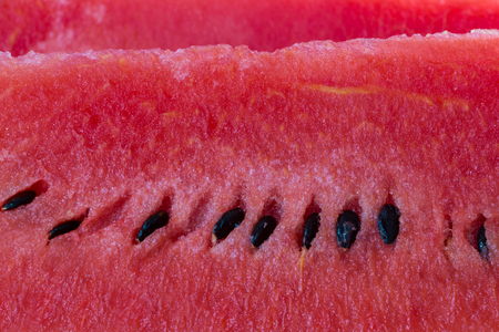 black seed: closeup of red watermelon and black seed Stock Photo