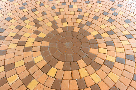 decorative balconies: Architectural background of an ornamental pattern in outdoor patio paving with bricks arranged in a circular pattern of concentric geometric circles