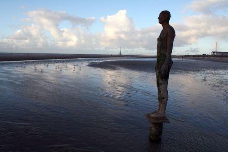 Antony Gormleys Another Place at Crosby Beach Stock Photo