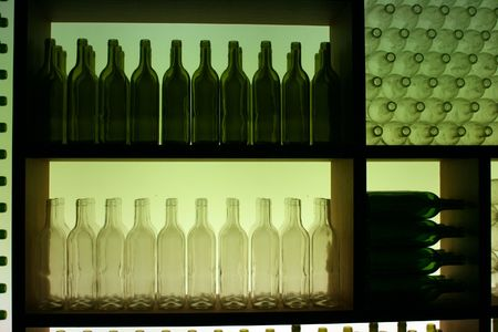 Display of Green and White Bottles