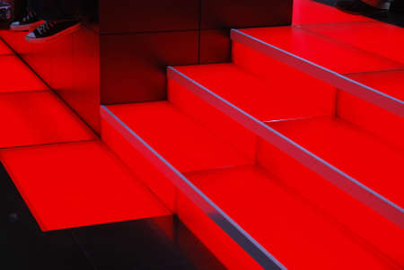 Feet dangle next to a set of glowing red stairs. Banco de Imagens