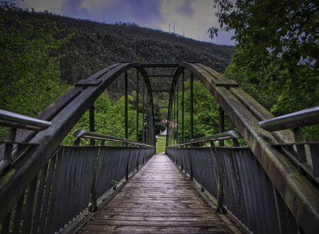 Iron bridge over the train tracks in Cantabria. Spain.