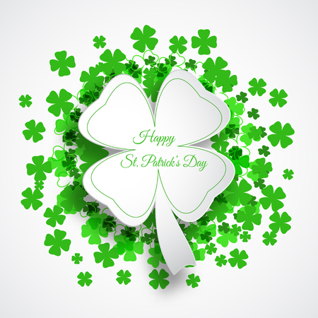 Vector Happy St. Patrick's Day poster on the white background with green leaf of clover shape cut from paper, text and clover leaves arranged in a circle.