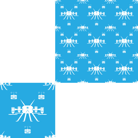 radio unit: Seamless isolated pattern of white quadrocopters and remote controls on the light blue background with pattern unit. Stock Photo