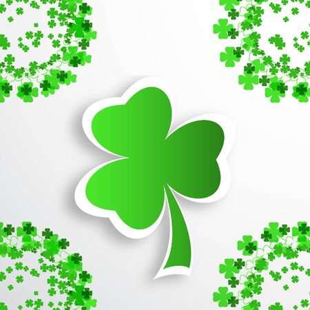 Poster of Happy St. Patricks Day on the gradient background with green leaf of clover and text cuted from paper, shadow and clover leaves arranged at the corners.