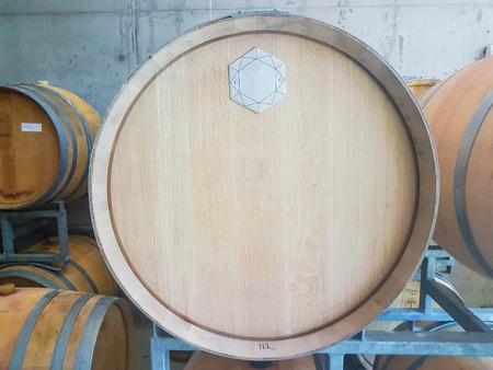 a wine barrels in a cellar 写真素材