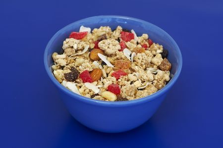 dry fruits: Muesli with dry fruits in a blue bowl