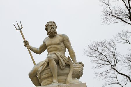 greek statue: Poseidon was a major civic god of several cities and god of the seas. Stock Photo