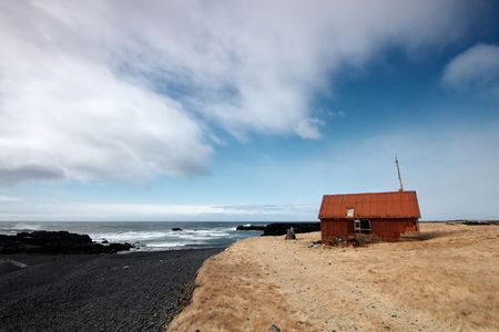 Abandoned house by black stone beach in Snefellsnes, Iceland Stock Photo - 6865372