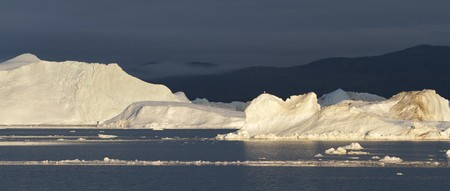 icefjord: Icebergs in the famous icefjord beside the city of Ilulissat in Greenland.  Stock Photo