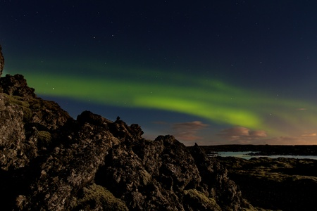 Green aurora or northern lights at the Blue Lagoon spa in Iceland photo