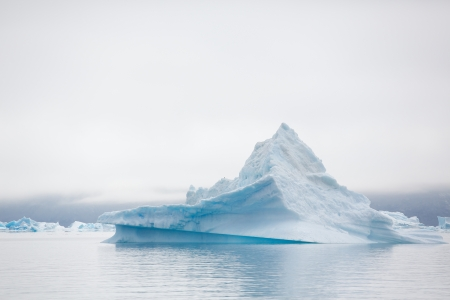 iceberg: Qooroq Icefjord in southern Greenland on a misty morning. Stock Photo