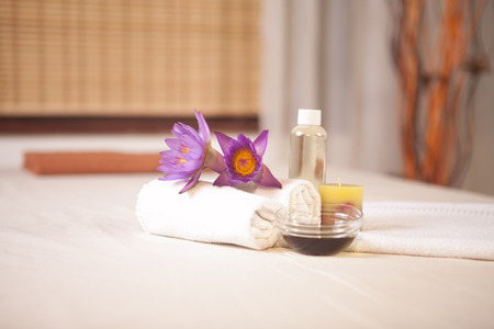 esthetic: flower, towel, oil on the bed