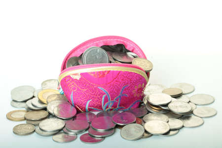 indian rupees coin overflowing from a  coin purse photo
