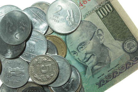 rupees: indian coins and hundred rupee note Stock Photo