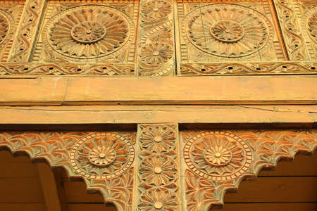 Rustic Carving on the doorway in an old castle in manali, india