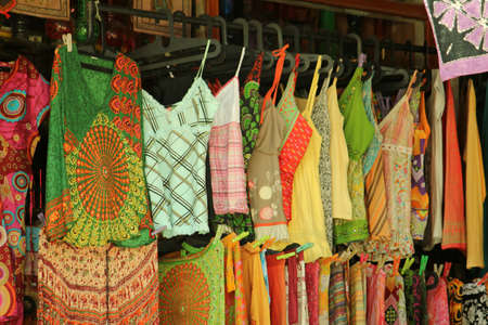 clothes rail: a shop selling Multicolored women s summer dress and tops Editorial