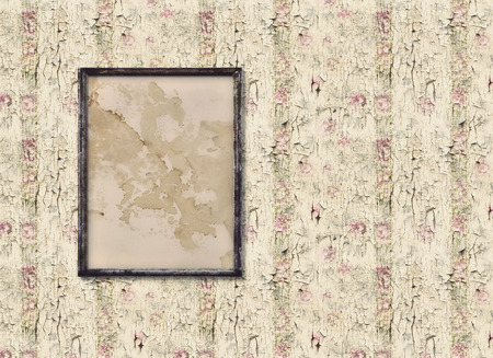 blotched: Old picture frame on an old vintage wall