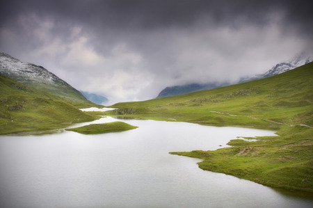 inshore: Mountain lake with dark clouds - Montafon, Austria