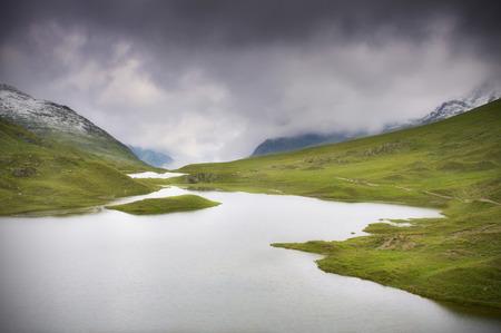 Mountain lake with dark clouds - Montafon, Austria