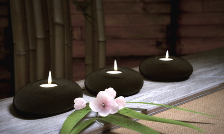 Candles in Stones With Bamboo And Cherry Blossoms Standard-Bild