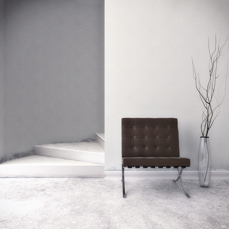 Brown Chair in front of a white wall