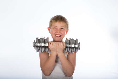 a young boy exercising with a dumbbell Stock Photo - 16764682