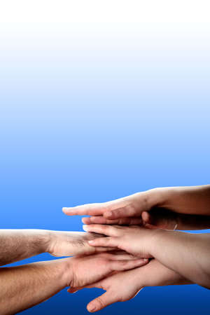 hands clasped showing determination over blue background photo