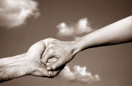 Holding hands and clear sky Stock Photo - 1942991